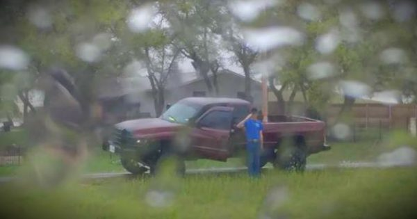 Stranger Stands In The Pouring Rain To Salute A Fallen Veteran