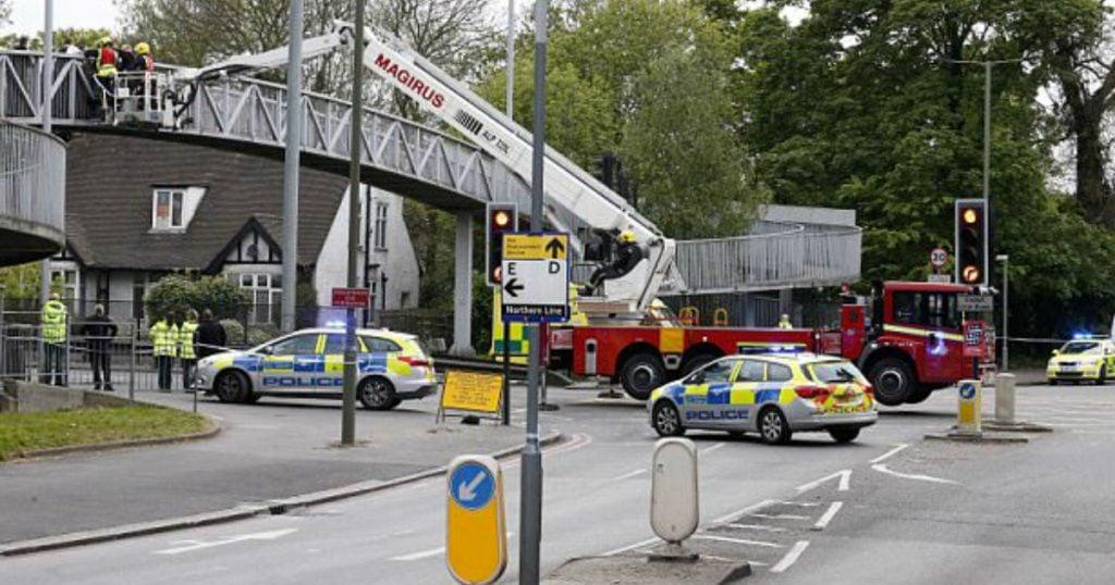 godupdates group of strangers hold suicidal man on bridge 1