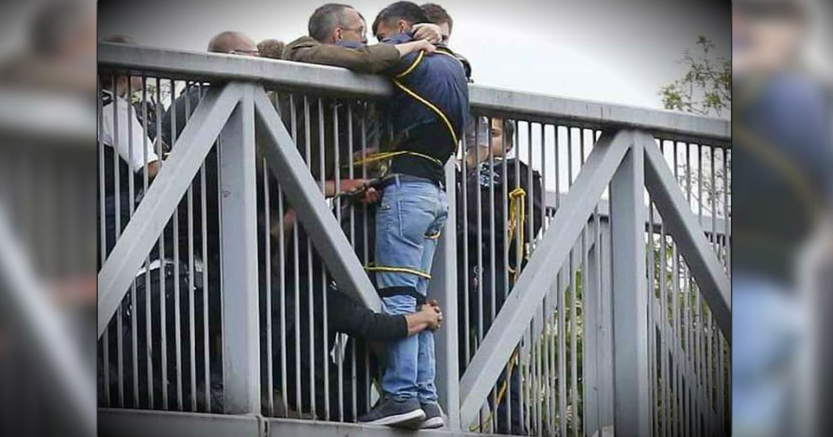 godupdates group of strangers hold suicidal man on bridge fb