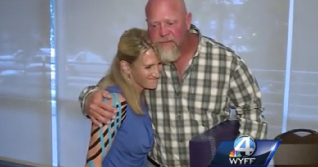 godupdates heroic utility worker saves woman from dog attack 1