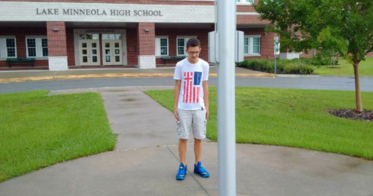 godupdates viral photo of boy standing alone at the flag pole praying fb