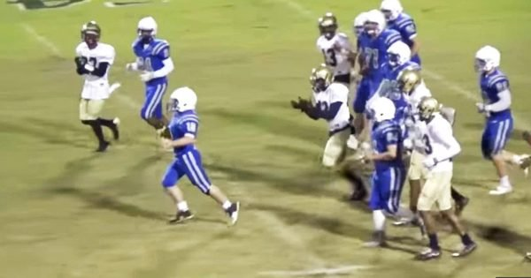 Rival Teams Come Together For The Touchdown Of The Year