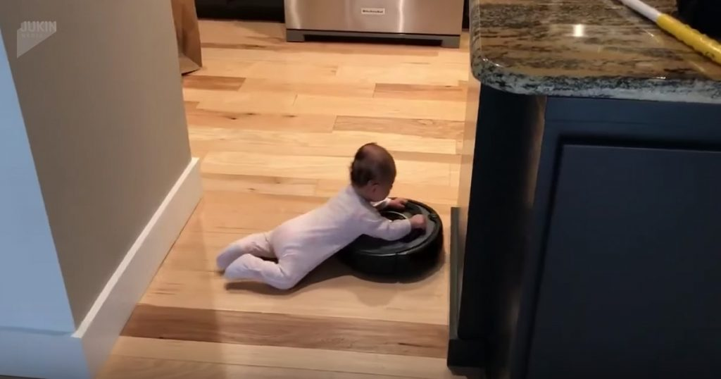Baby Hilariously Hitches A Ride On A Roomba