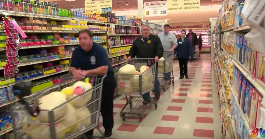 Firefighters Help Families In Need At Thanksgiving