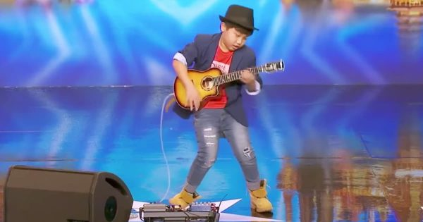 Kid Guitarist's Performance Wows Crowd