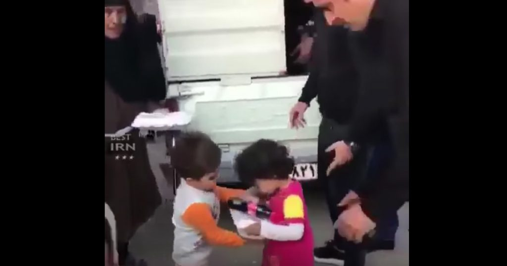 Boy Helps Girl Get Food After Earthquake