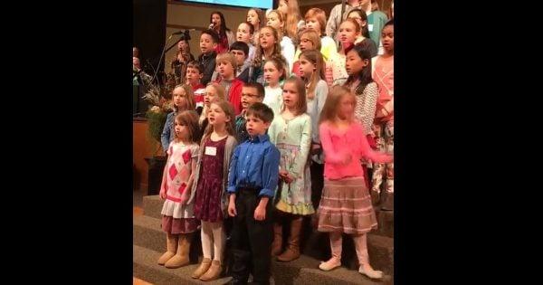 Little Girl Sings and Dances in Church Choir