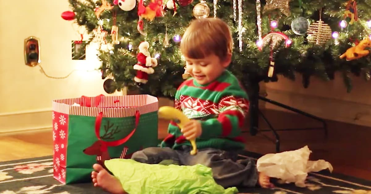 Little Boy Receives Present Vegetables For Christmas