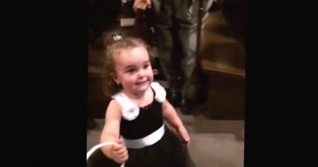 Flower Girl Stops In The Middle Of The Aisle To Say Hi To Dad