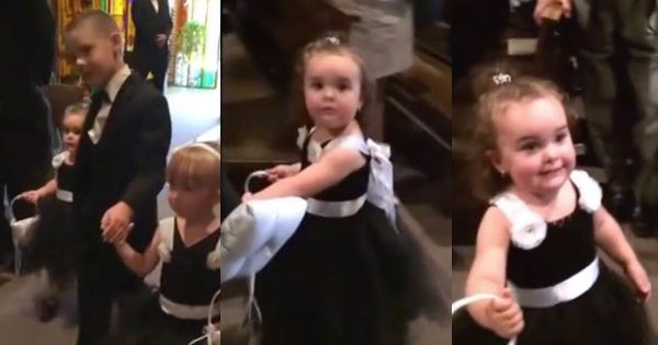 Hilarious Flower Girl Stops To Say Hi To Her Daddy