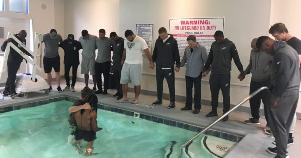 NFL Football Player Gets Baptized Surrounded By His Teammates