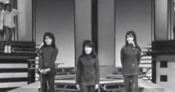 Singing Group Performs Classic Hit In The 1960's