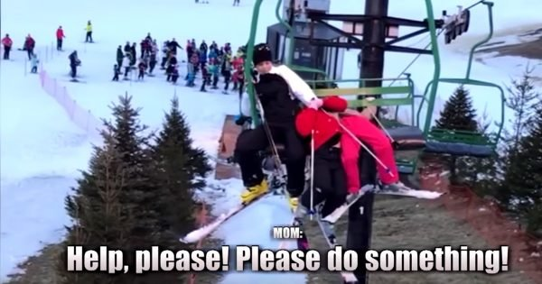 Mother Clings To Baby Girls As They Dangle From A Ski Lift