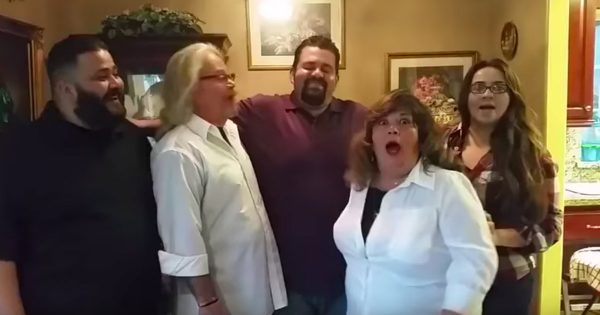 In-Laws Are Surprised With A Pregnancy Announcement During Their Family Picture