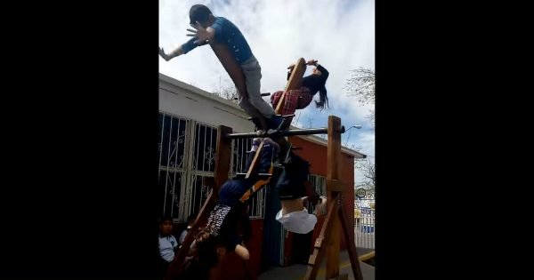 Children Learn How To Master Teamwork On A Playground Contraption