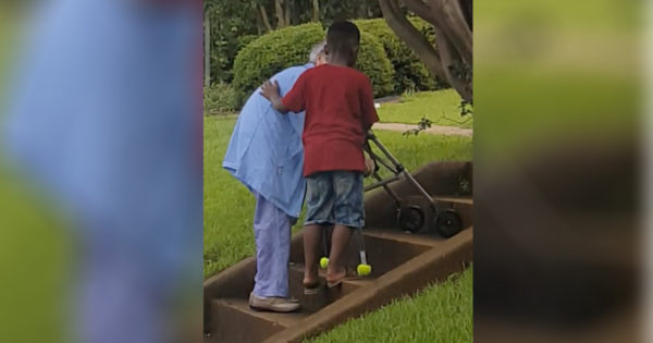 8-Year-Old Helps Elderly Woman Climb Stairs