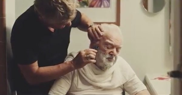 Adult Son Cares For His Elderly Father In The Most Loving Way