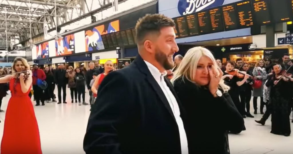 Flash Mob Surprise Orchestra Proposal At Busy Train Station