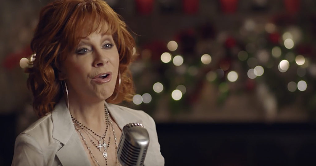 Reba McEntire Sets The Christmas Mood With 'I'll Be Home For Christmas'