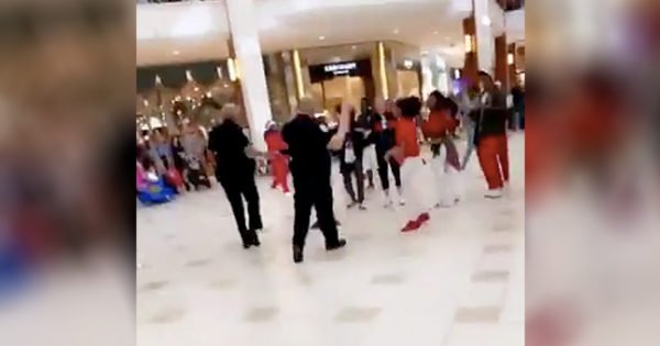 Police Officers Leave Crowd Stunned As They Join In Mall Flash Mob