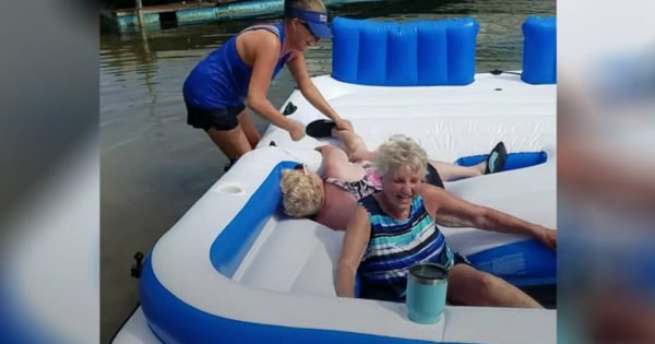 2 Grandmas Can't Stop Laughing Long Enough To Get Off An Inflatable Raft And It's Hilarious
