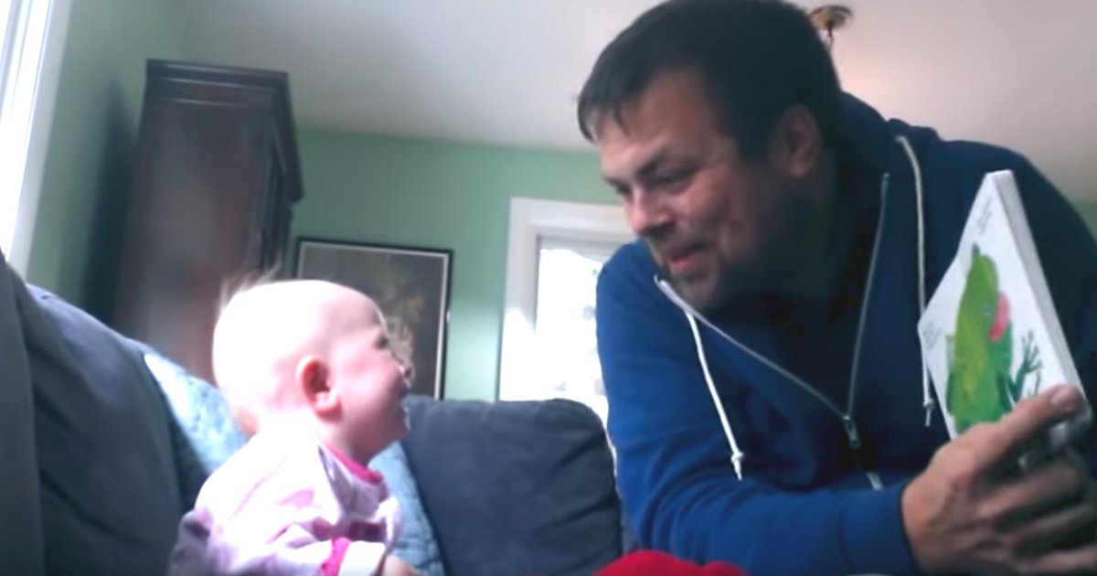 baby laughing hysterically as uncle reads brown bear