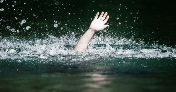 man drowning in river