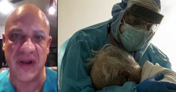 Heart-Wrenching Image of a Doctor Holding an Elderly Patient Goes Viral