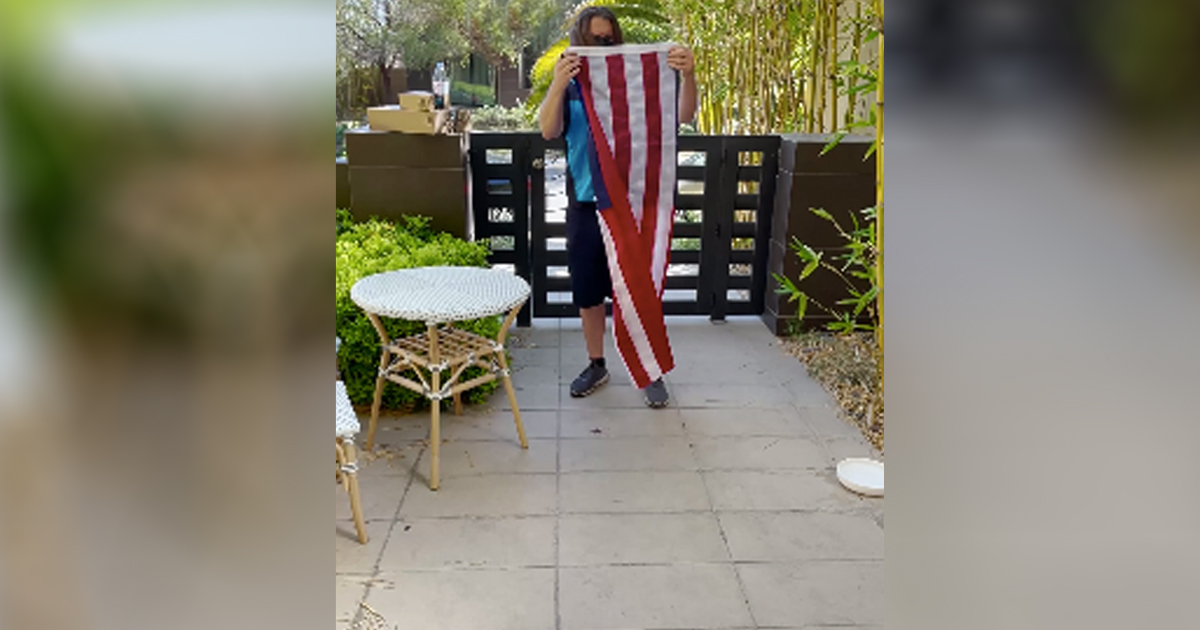 delivery driver folded American flag