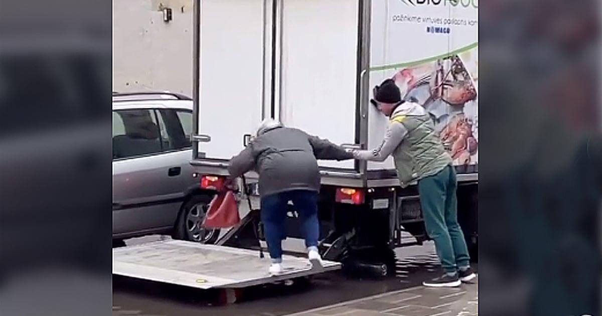 truck driver helps elderly woman