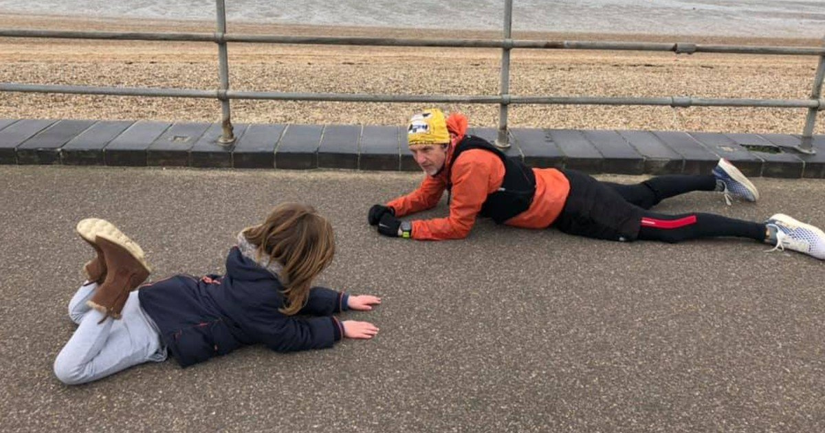 little boy with autism stranger lays on ground
