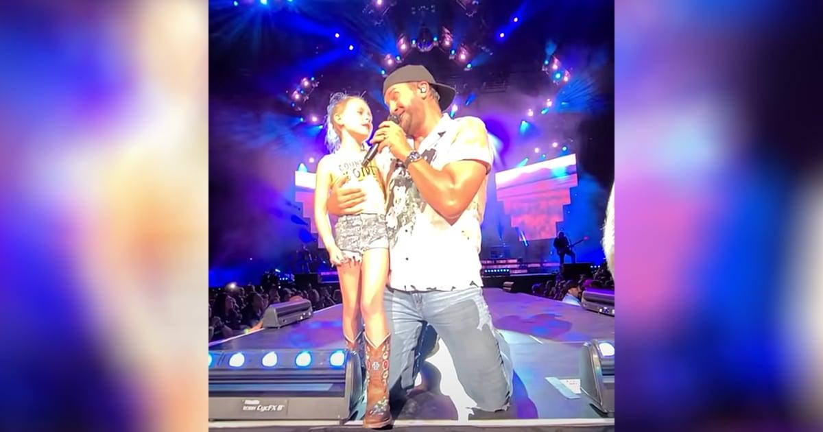 Luke Bryan brings fan on stage
