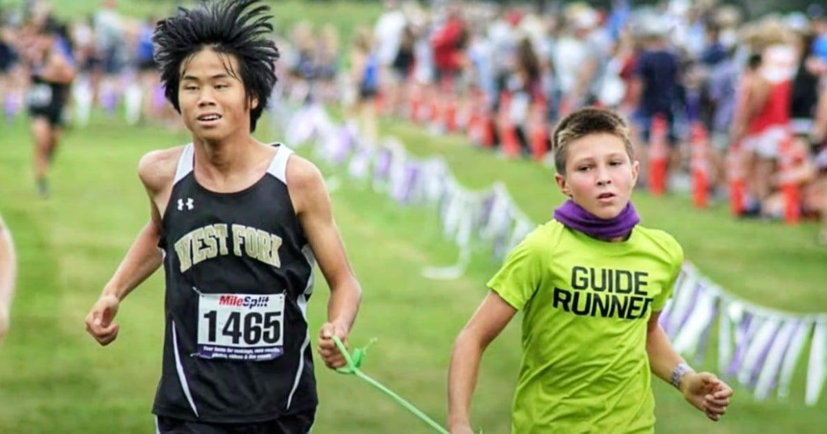 blind runner guide volunteer rebel hays